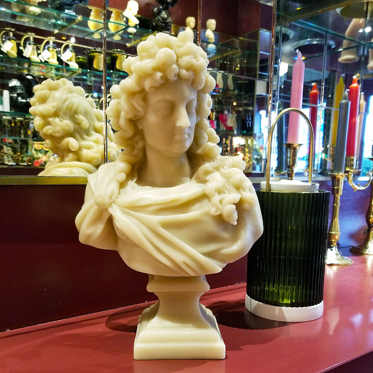 A sculptured Louis XIV candle.