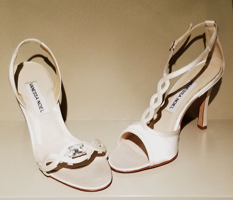 White satin sandals in the Vanessa Noel boutique