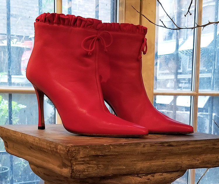 Vanessa Noel red boots