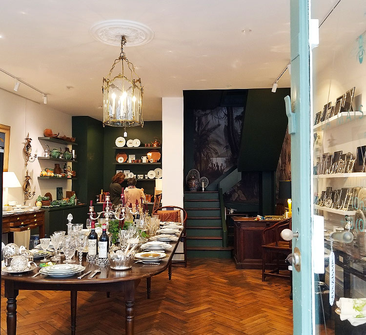 A boutique full of of china and silver in Paris