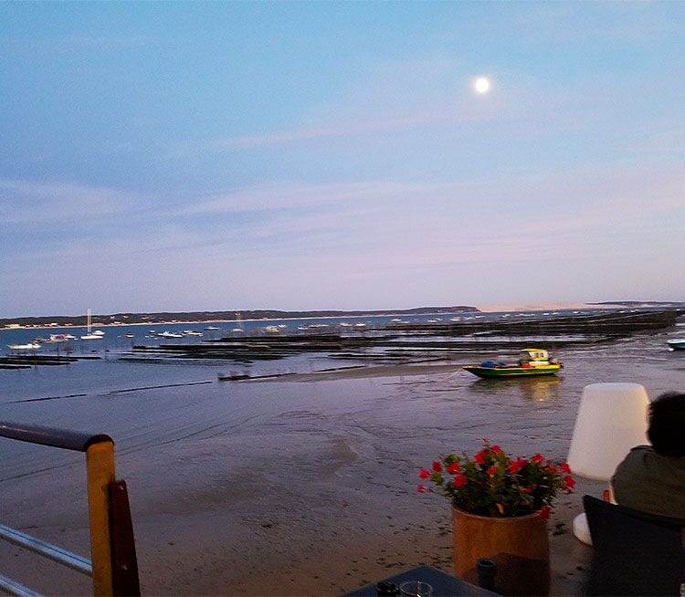 The moon rising over the Bassin of Arcachon