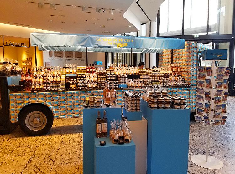A fancy food truck full of goodies in the Grand Epercierie de Paris