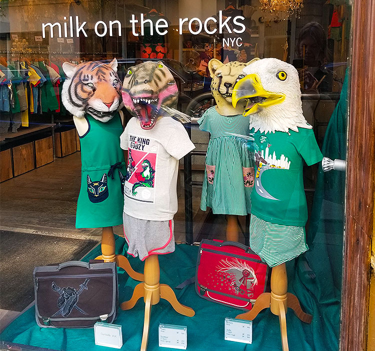 Children's clothing on display in a shop window in Paris