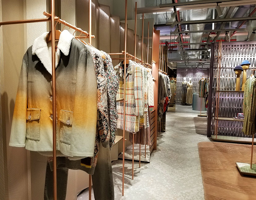 Casual clothes and a view of the industrial chic store design