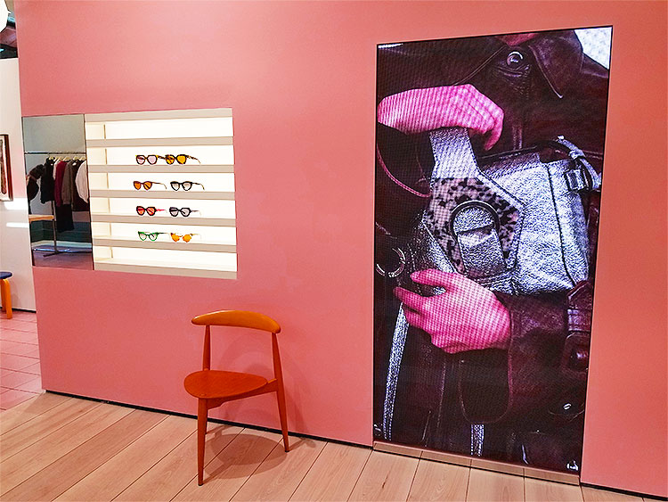Video screens in the Ganni boutique in Soho