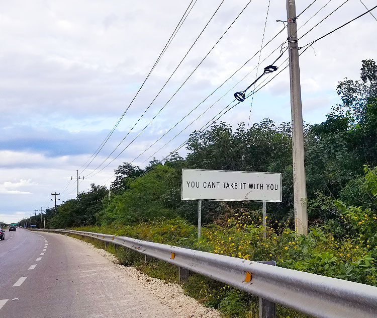 A Tulum Road Sign